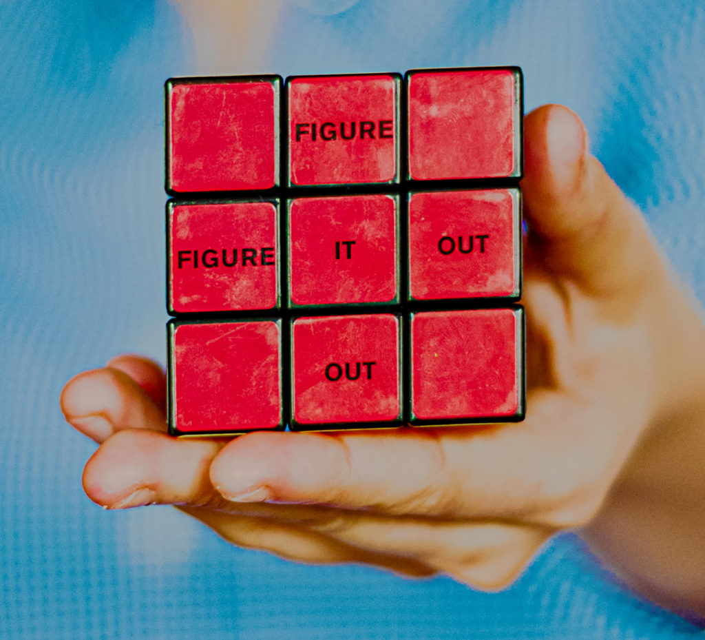 """Zauberwürfel mit Aufschrift """"Figure it out"""""""