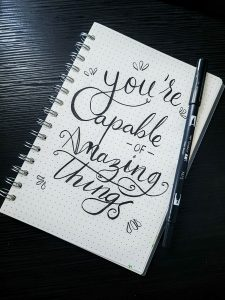 """Block mit Text """"You're capable OF amazing things"""""""